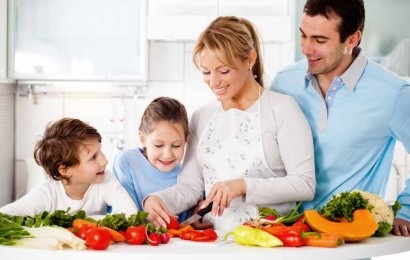 Happy family is preparing a healthy dinner in the kitchen. Mother is cutting vegetables.    [url=http://www.istockphoto.com/search/lightbox/9786778][img]http://img143.imageshack.us/img143/364/familyyv.jpg[/img][/url]